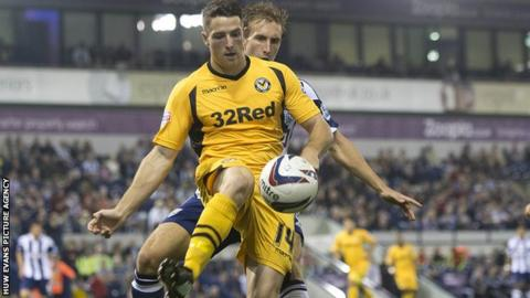 Newport's Conor Washington battles for the ball with West Brom's Craig Dawson.