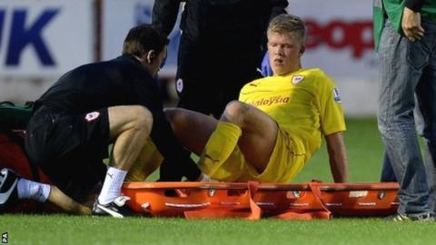 The stretcher comes out for Andreas Cornelius of Cardiff City