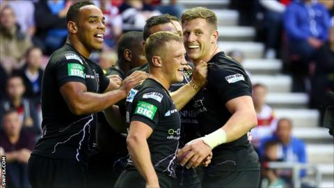 Huddersfield Giants players celebrate a try in the win at Wigan