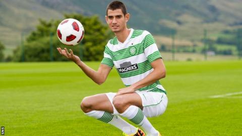 Israel midfielder Nir Biton poses in his new Celtic kit