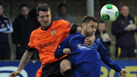 Gareth McKeown and Jamie Douglas in action during Glenavon's 3-3 draw with Dungannon Swifts at Stangmore Park