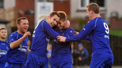 Stefan Lavery is congratulated by team-mates after opening the scoring for Dungannon against Glenavon