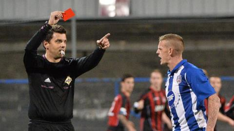 Referee Andrew Davey shows a red card to Coleraine's Aaron Canning at Ballycastle Road