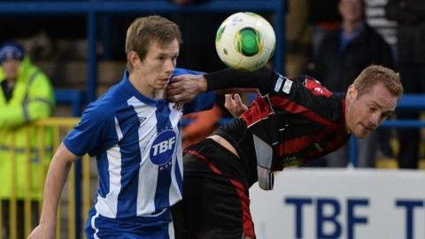 Johnny Watt and Timmy Adamson contend for the ball as Coleraine draw 2-2 with Crusaders