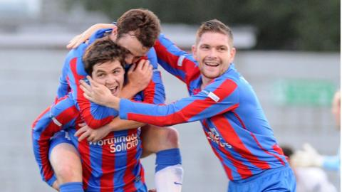Ben Roy is congratulated after scoring the first of Ards' two goals in their win over Ballymena United