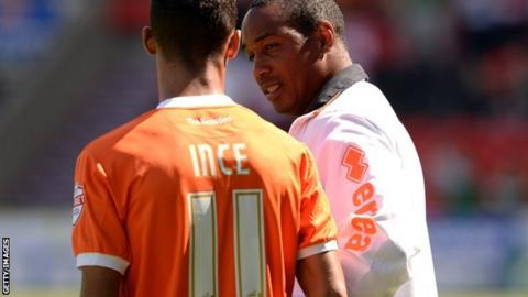 Tom Ince and Paul Ince (right)