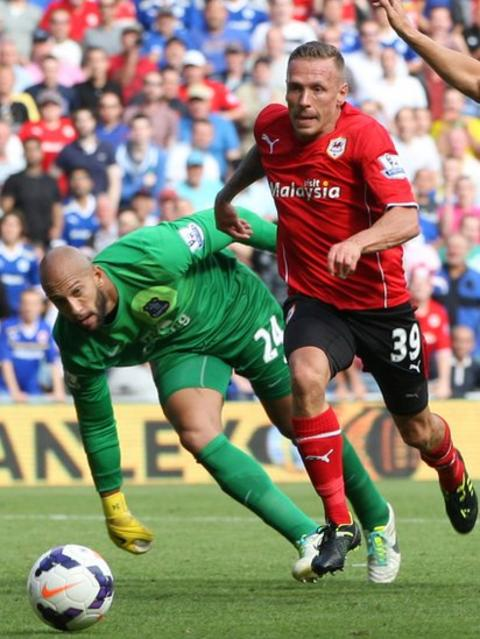 Craig Bellamy gets beyond Everton goalkeeper Tim Howard