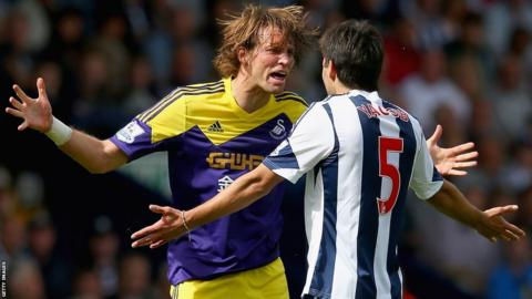 Michu and Claudio Yacob clash