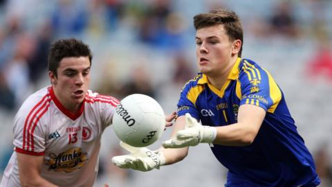 Lee Brennan tracks the progress of Shane Mannion who attempts to execute a pass for Roscommon