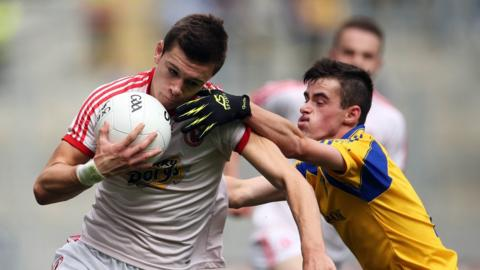 The impressive Conor McKenna secures possession for Tyrone as Jack Earley puts in a challenge