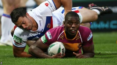 Huddersfield Giants Jermaine McGillvary scores a try