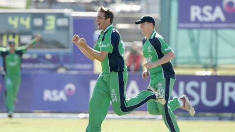 Tim Murtagh takes the wicket of James Taylor to leave England struggling at 48-4 in reply to Ireland's total of 269