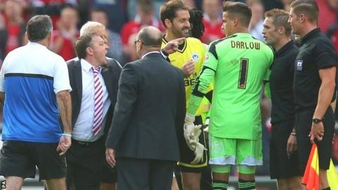 Nottingham Forest manager Billy Davies confronts officials after the game against Wigan