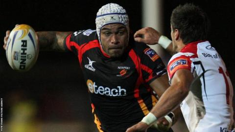 Debutant Netani Talei takes on Ulster's David McIlwaine as the Dragons secure an impressive 15-8 win at Rodney Parade.
