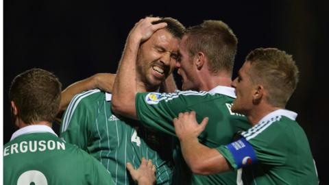 Central defender Gareth McAuley is congratulated after heading home Northern Ireland's equaliser to make it 1-1
