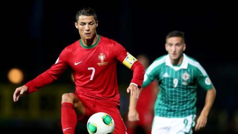 Portugal hat-trick hero Cristiano Ronaldo shields the ball from Martin Paterson