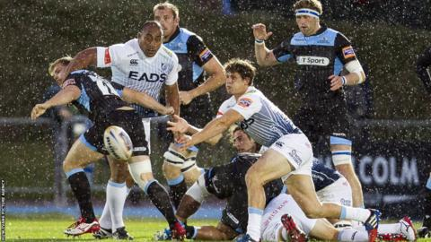 Scrum-half Lloyd Williams clears from a ruck during Cardiff Blues' opening game of the Pro12 season away to Glasgow Warriors.