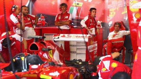 Fernando Alonso and his Ferrari team