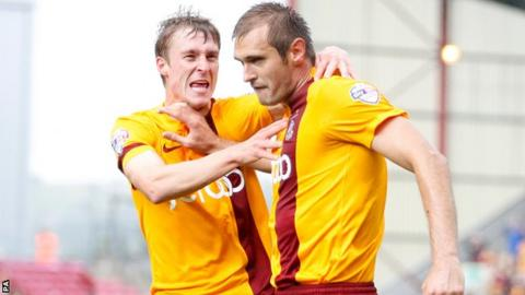Bradford's James Hanson (right) celebrates his first goal