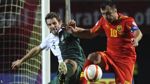 Wales defender Sam Ricketts, left, challenges Macedonia's Goran Pandev