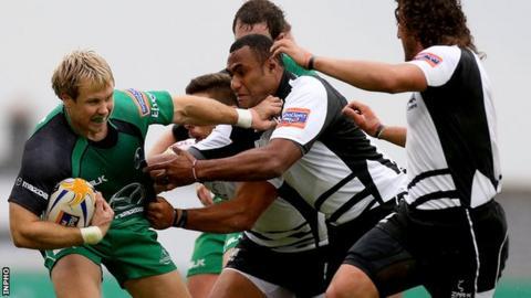 Connacht's Fionn Carr tries to fend off Kameli Ratuvou of Zebre