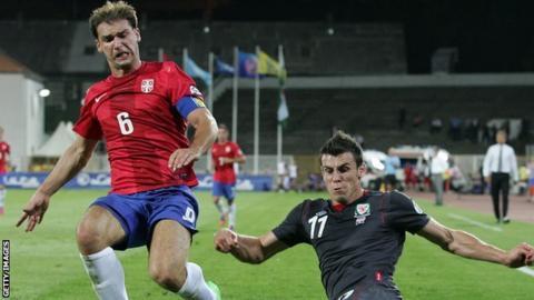 Branislav Ivanovic takes on Gareth Bale as Wales lost 6-1 in September 2012