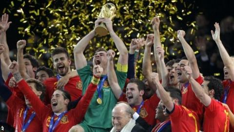 Spain team members celebrate with the World Cup trophy in 2010
