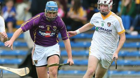 Jackson McGreevy (right) battles with Wexford's Aaron Kenny in the All-Ireland semi-final