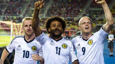Iketchi Anya (centre) celebrates with Scotland