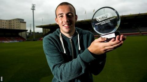 Stuart bannigan with his award