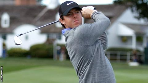 Rory McIlroy watches his shot at the third hole on Friday