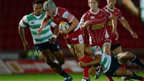 British and Irish Lions centre Jonathan Davies makes his return for the Scarlets as a 61st minute replacement in the Pro12 win over Treviso.