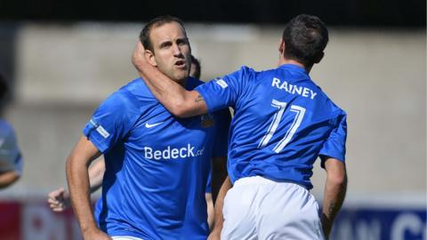 Guy Bates and David Rainey scored goals in Glenavon's 4-1 win over Dungannon Swifts