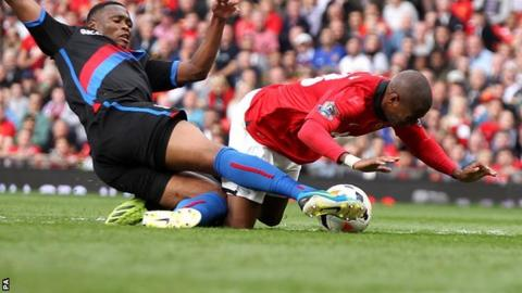Manchester United's Ashley Young (right) is tackled by Kagisho Dikgacoi in the incident which saw the Crystal Palace man sent off