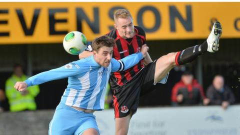 John Boyle and Timmy Adamson compete for the ball in Warrenpoint Town's 1-1 draw with Crusaders