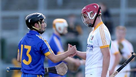 Cathal O'Connell consoles Michael Bradley after Clare defeat Antrim 2-28 to 0-12 in the All-Ireland Under-21 Hurling final