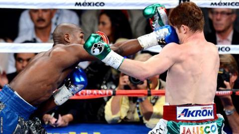 Floyd Mayweather connects against Saul Alvarez