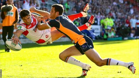 Tommy Makinson goes airborne to score a try for St Helens against Hull KR