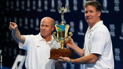 Jack Bauerle and David Marsh of the United States lift the trophy in Atlanta
