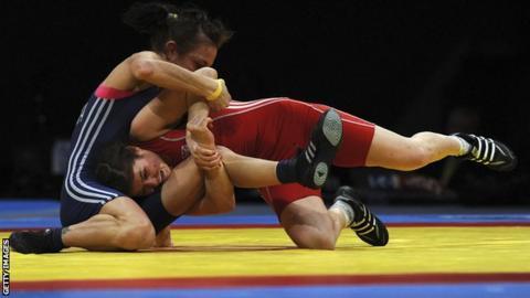 Yana Stadnik (in red) in action