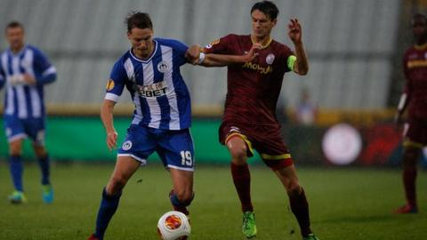 Nick Powell contests a challenge
