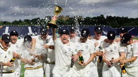 Durham celebrate with the County Championship trophy
