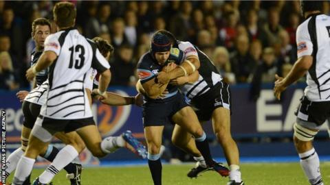 Cardiff Blues full-back Leigh Halfpenny is stopped by the Zebre defence