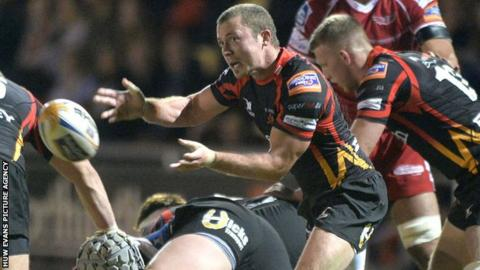 Richie Rees passes the ball from the base of a maul against Scarlets