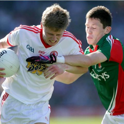 Padraig McGirr of Tyrone attempts to hold off Mayo's Sean Conlon during the Minor football final at Croke Park