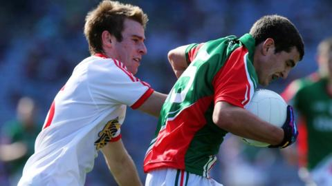 Shae Hamill of Tyrone attempts to halt a charge by Mayo forward Tommy Conroy at Croke Park