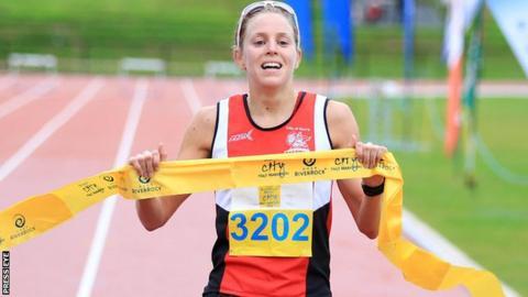 Aileen Reid crosses the line in the Belfast Half Marathon