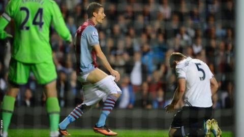 Nicklas Helenius of Aston Villa complains to the referee after having his shorts pulled down by Jan Vertonghen of Tottenham Hotspur during the Capital One Cup third round match between Aston Villa and Tottenham Hotspur at Villa Park