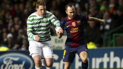 Andres Iniesta in action for Barcelona with Kris Commons