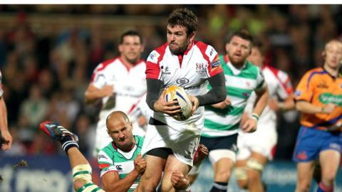 Ulster centre Jared Payne is tackled by Benetton Treviso players Mat Berquist and Simone Favaro